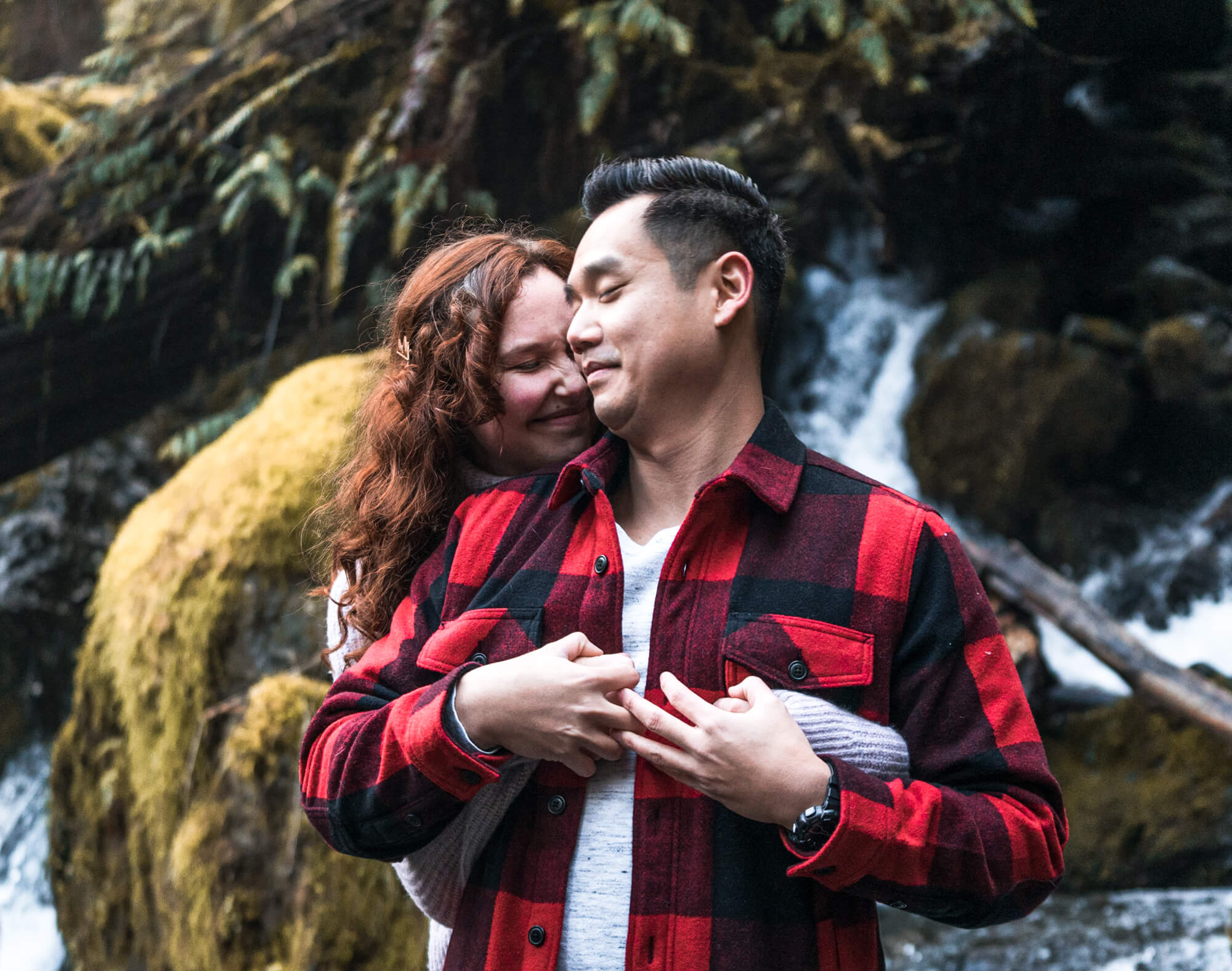 pre-wedding shoot by the waterfall in rainy forest