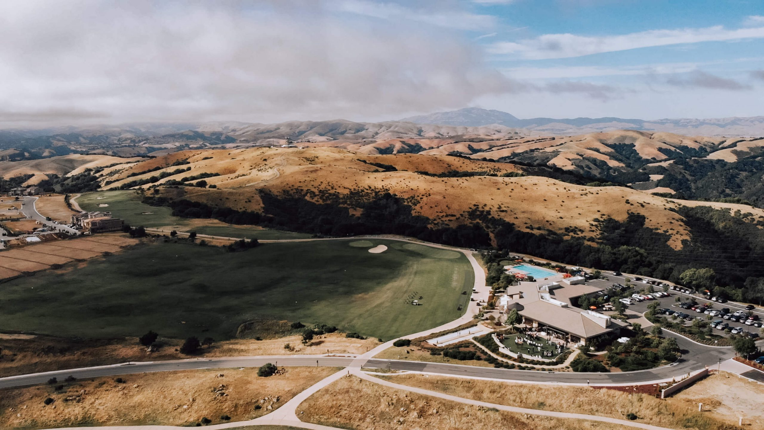 Drone shot of the wedding venue Stonebrae Country Club, Hayward, CA under the clouds