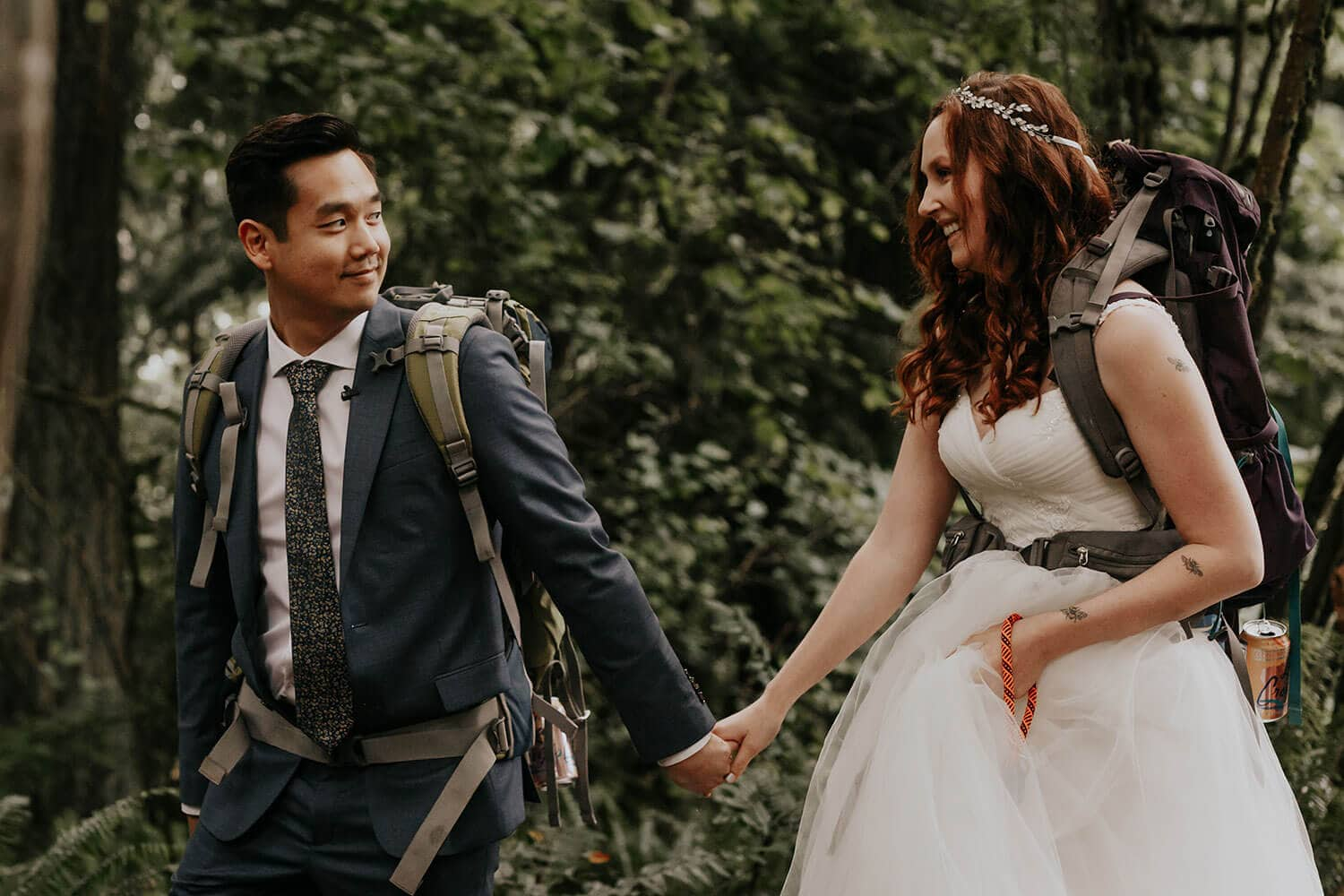 Bride and groom hiking with backpacks in Seattle after they got married at home
