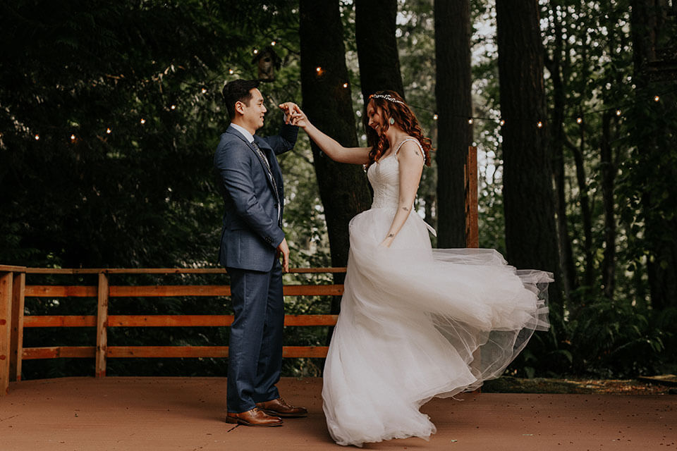 First dance of the bride and groom on a backyard of their own house in Seattle WA