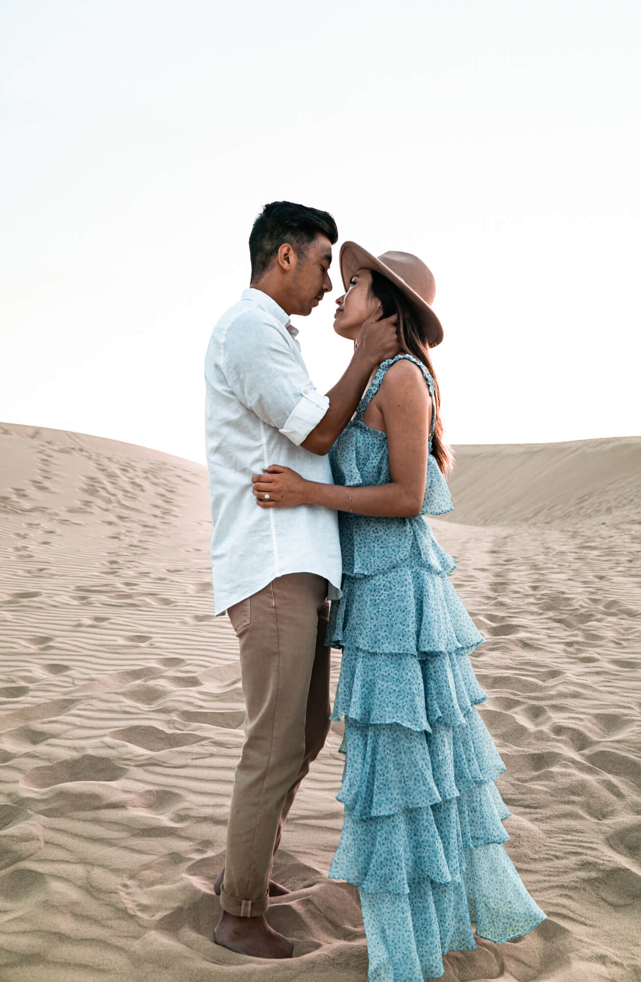 Romantic couple having pre-wedding shoot in sand dunes