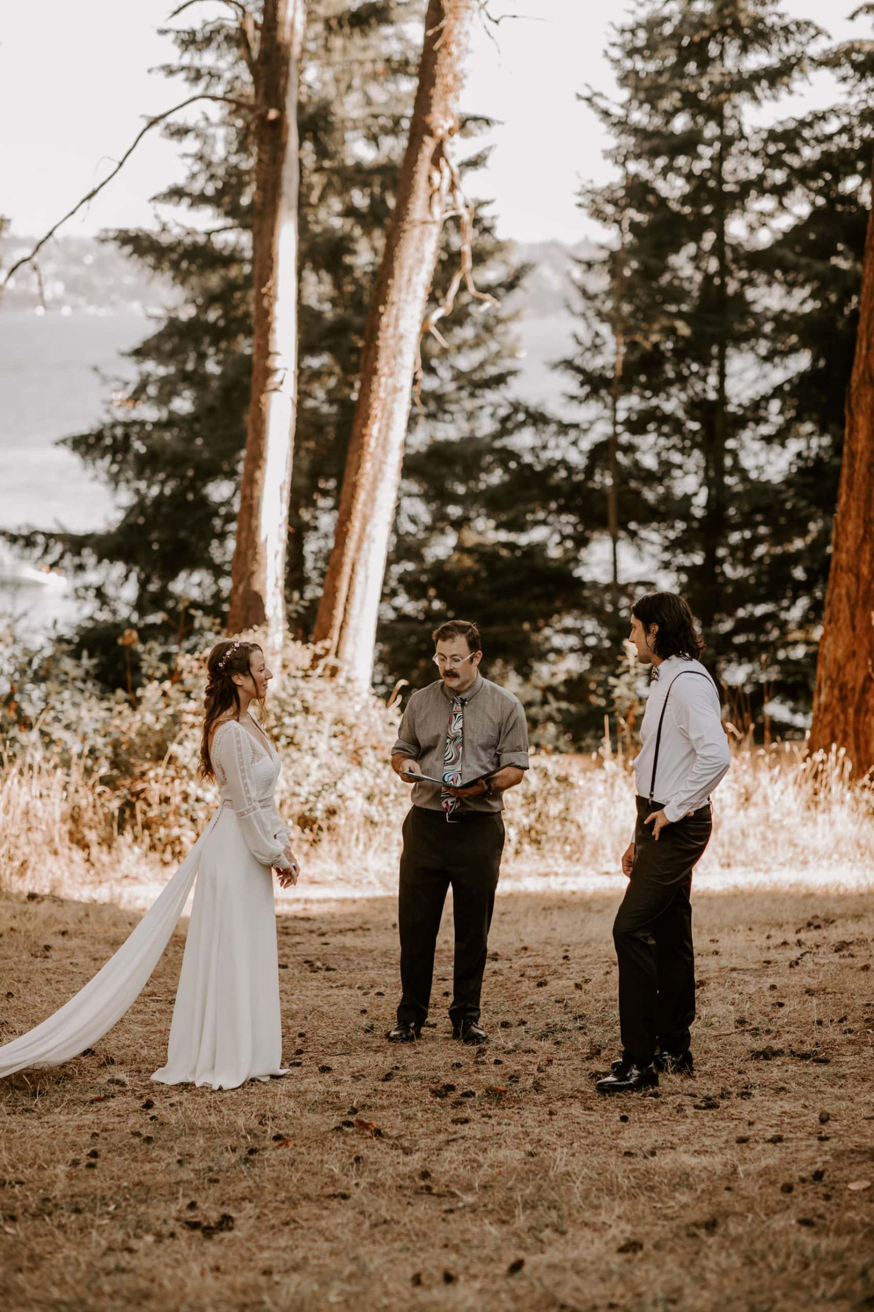 Bride and groom exchanging the vows during a small wedding ceremony in Seward Park, Seattle