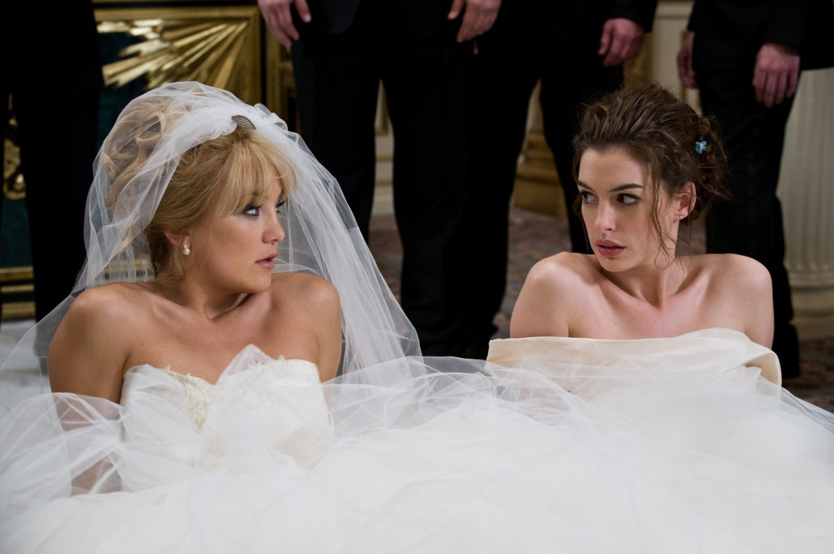 Wedding Movie scene from 'Bride Wars', brides laying on the ground in their wedding dresses