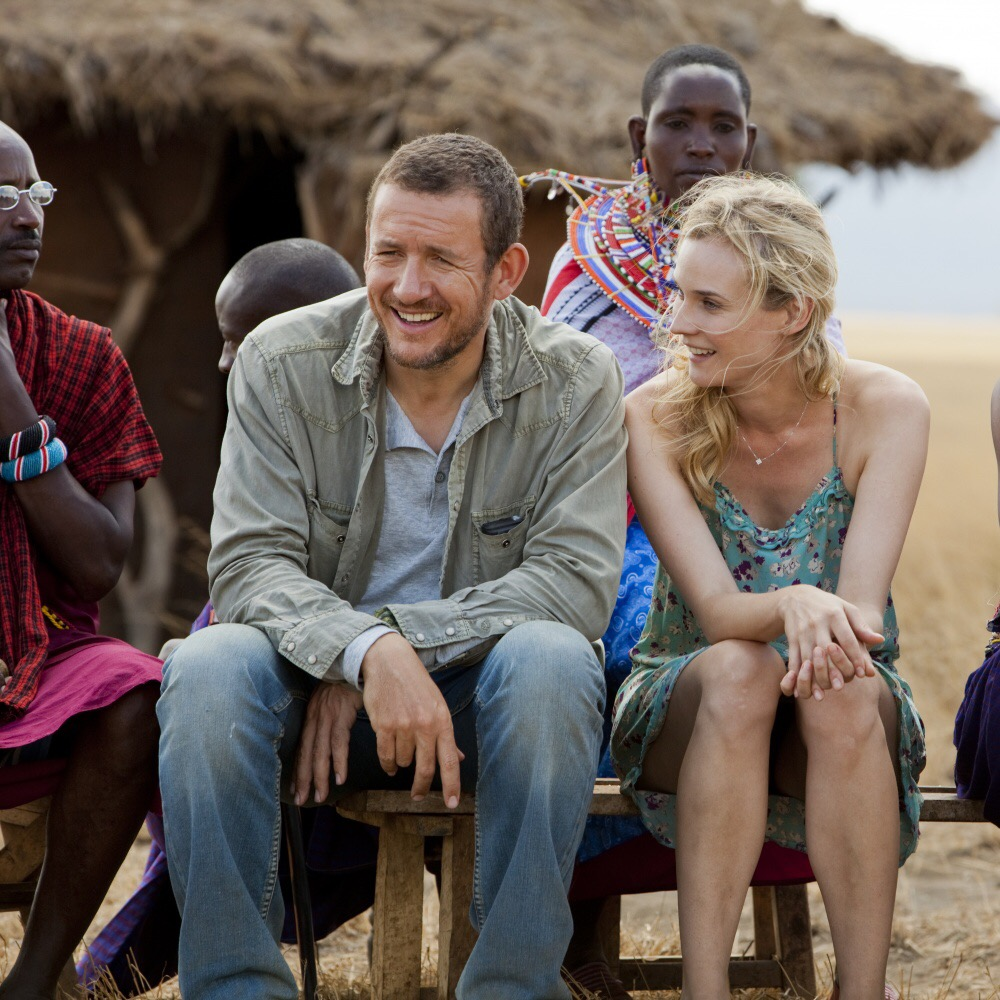 Movie scene from 'A perfect plan' where bride and groom watching African wedding ceremony