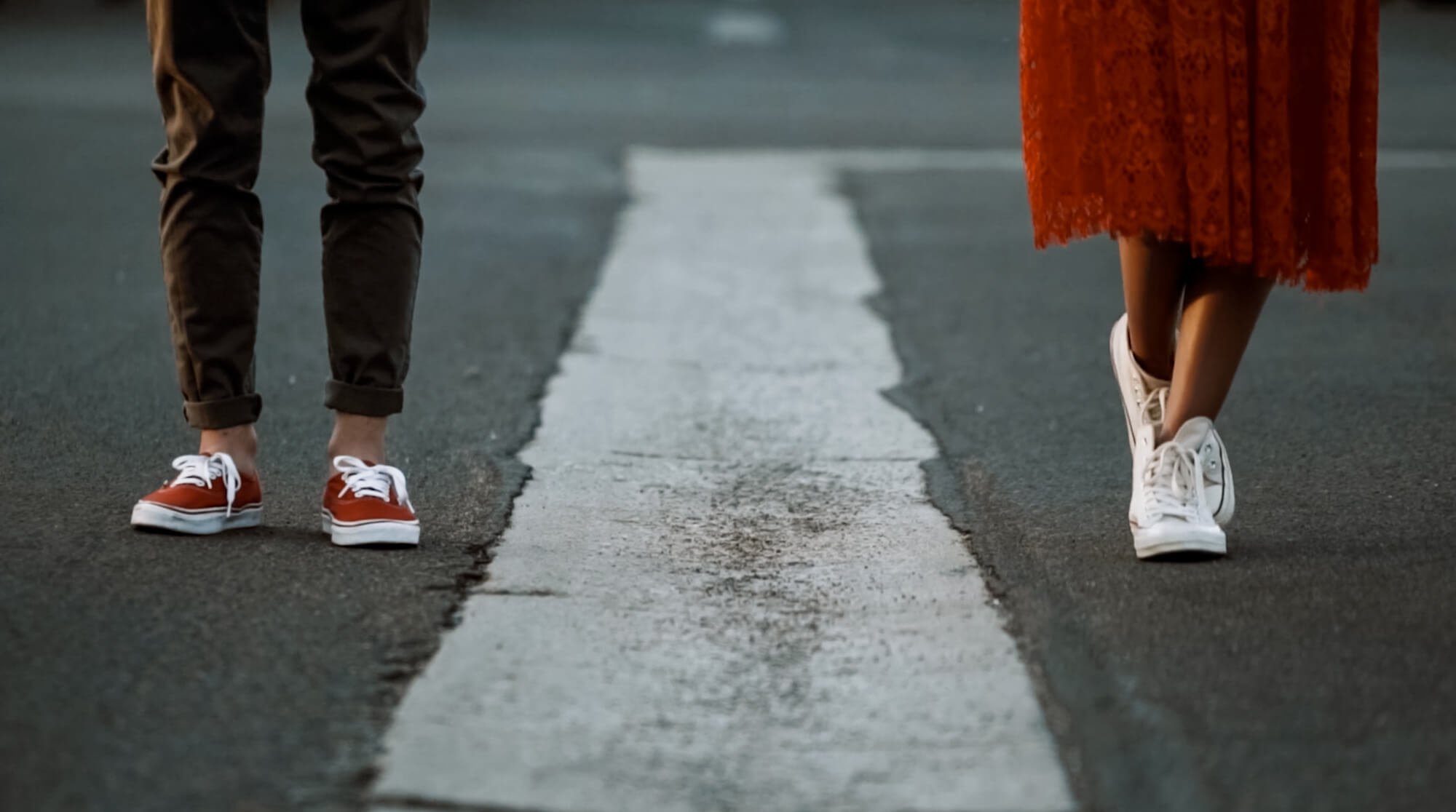 couple wearing sneakers and converse