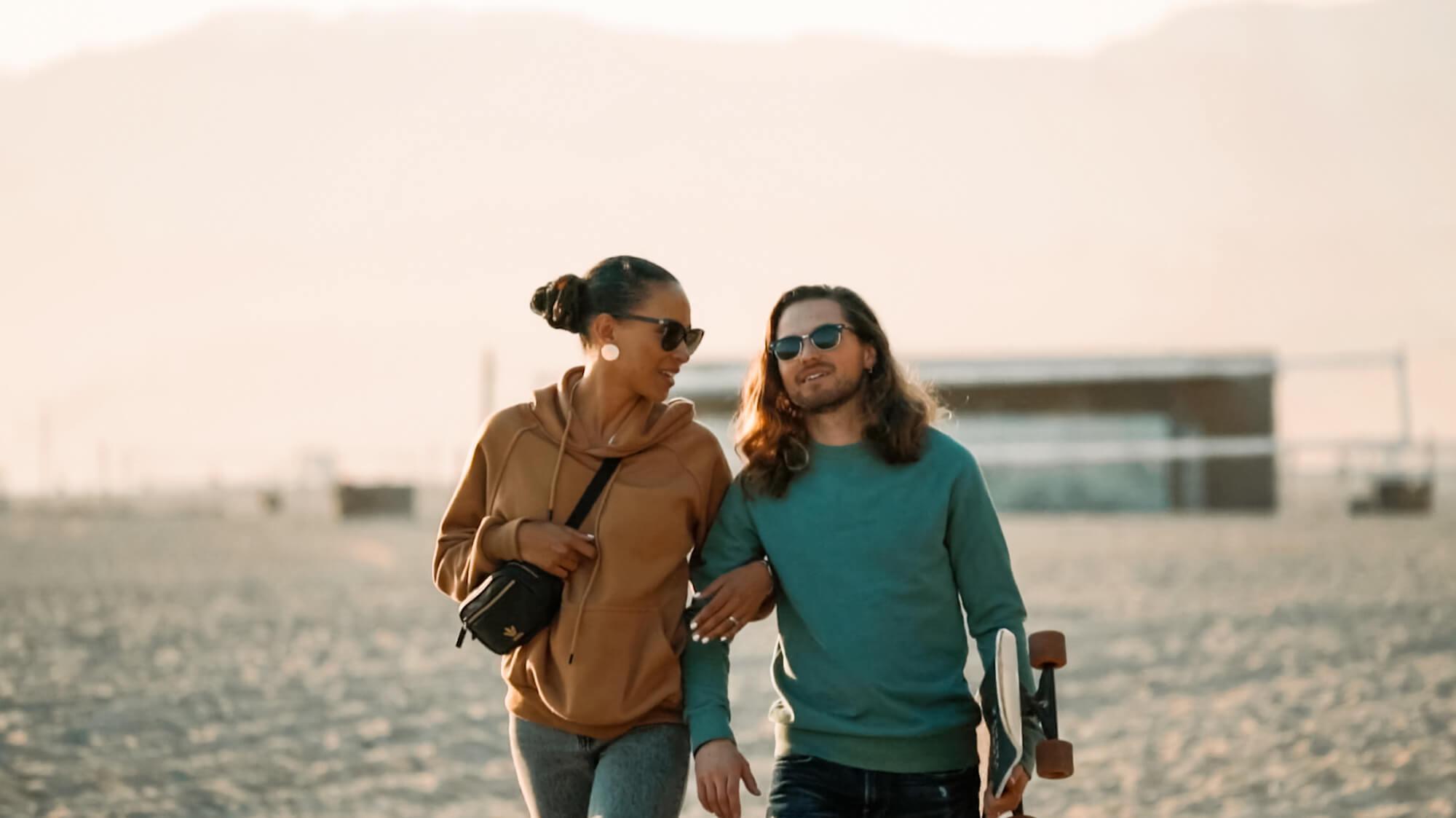 interracial couple walking on the beach Santa Monica, CA