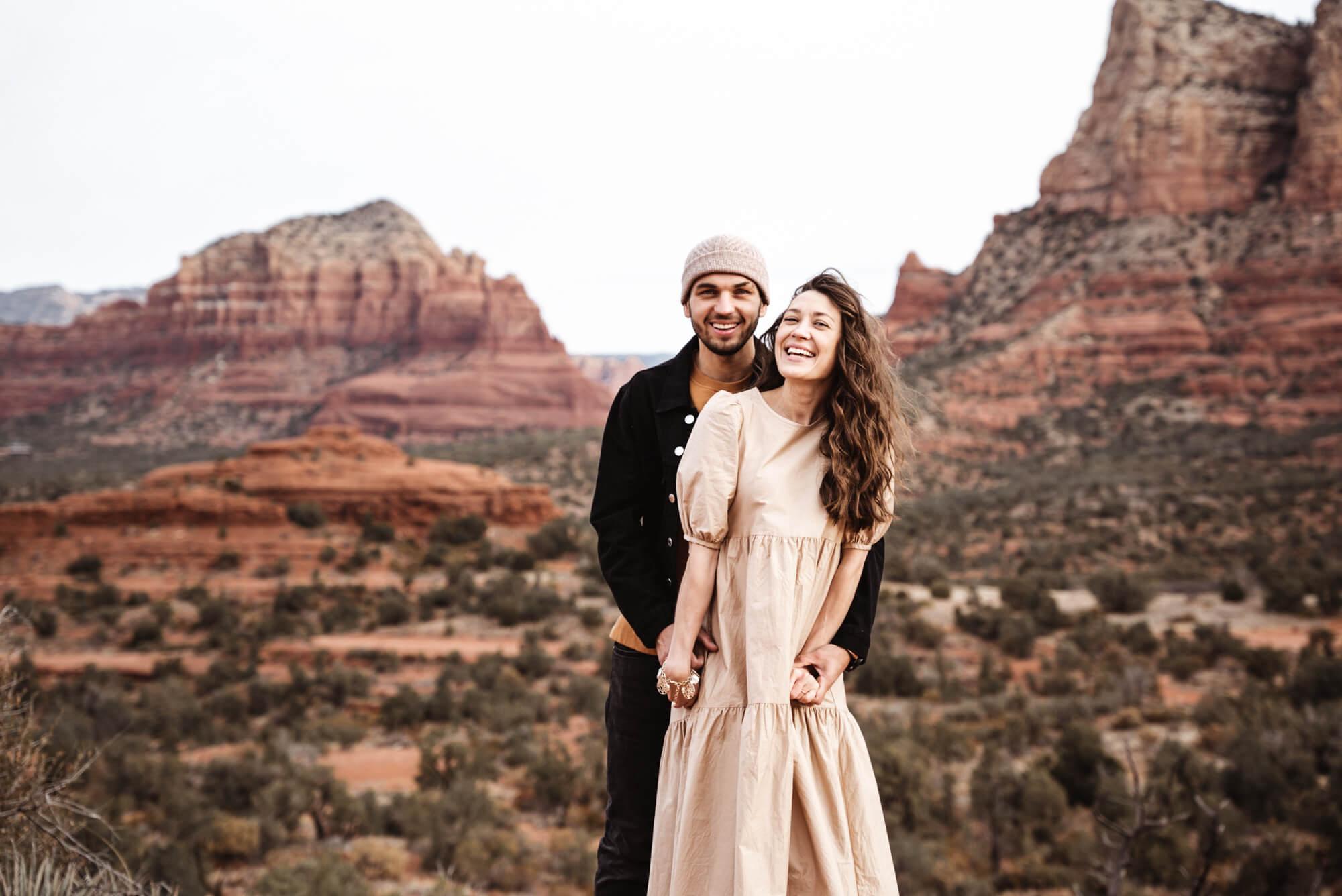 wedding videographer standing on bell rock in sedona az